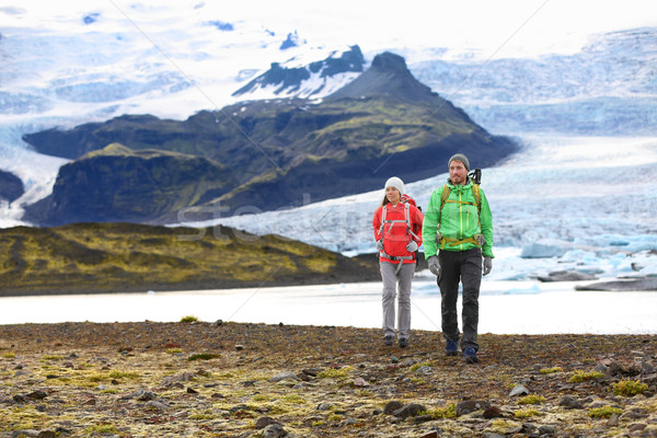 Adventure hiking travel couple trekking on Iceland Stock photo © Maridav