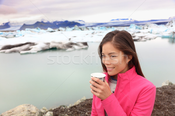 Woman drinking coffee on travel trip on Iceland Stock photo © Maridav