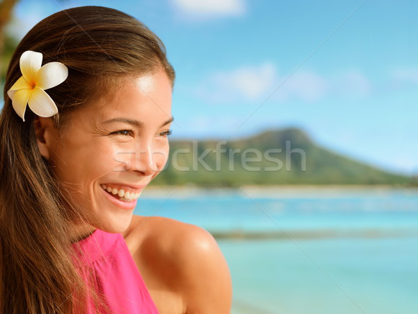Happy Woman With Frangipani Flower In Hair  Stock photo © Maridav