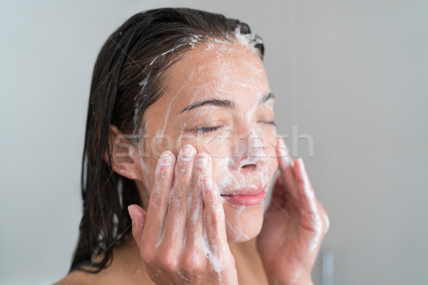 Skincare woman washing face in shower Stock photo © Maridav