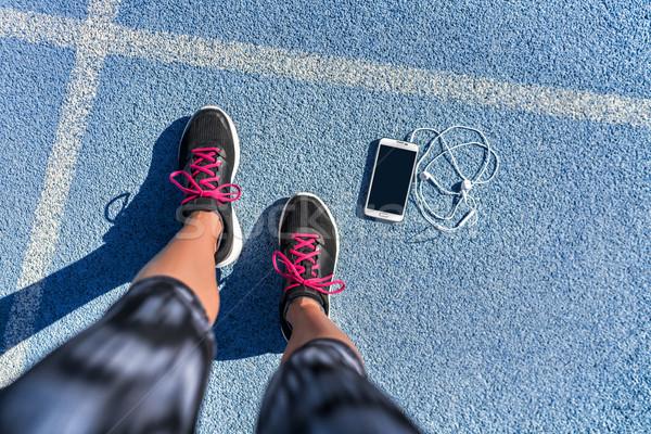 Running shoes girl feet selfie on run track lane Stock photo © Maridav