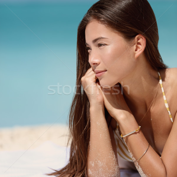 Asian young woman happy relaxing on beach Stock photo © Maridav