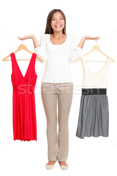 Woman choosing dresses Stock photo © Maridav