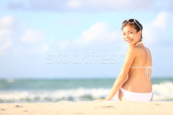 Vacation woman sitting on beach Stock photo © Maridav