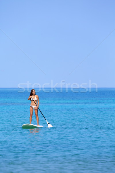 Hawaii beach lifestyle woman paddleboarding Stock photo © Maridav