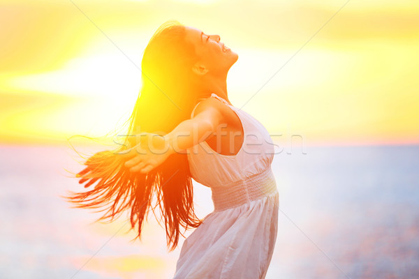 Stock photo: Enjoyment - free happy woman enjoying sunset