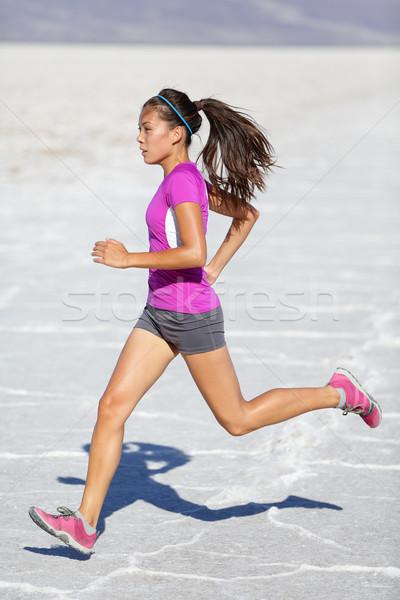 Running woman - runner sprinting on trail run Stock photo © Maridav