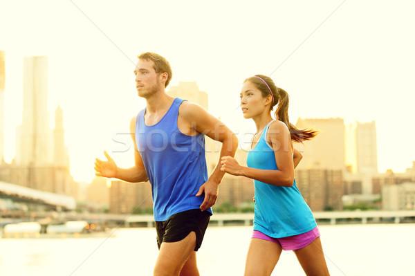 City running couple jogging outside Stock photo © Maridav