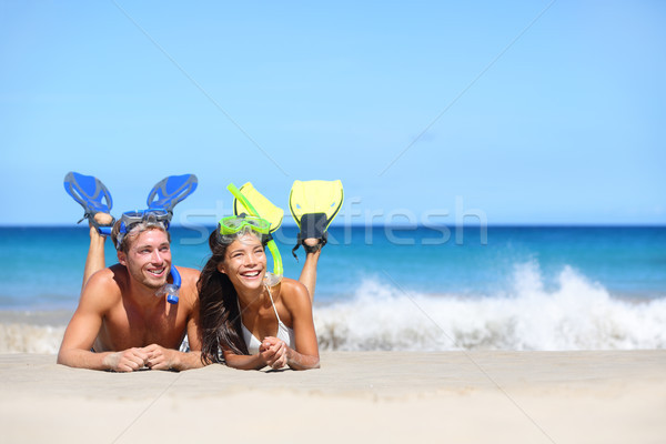 Beach travel couple having fun snorkeling looking Stock photo © Maridav