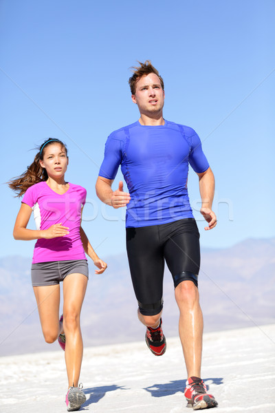 Running sport athlete man sprinting in trail run Stock photo © Maridav