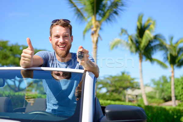 Car driver showing keys and thumbs up happy Stock photo © Maridav