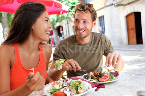 Restaurant tourists couple eating at outdoor cafe Stock photo © Maridav