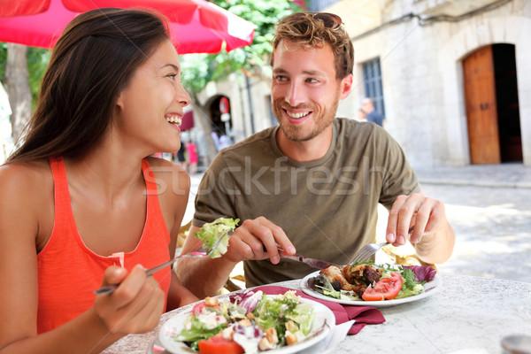 Restaurante turistas casal alimentação ao ar livre café Foto stock © Maridav