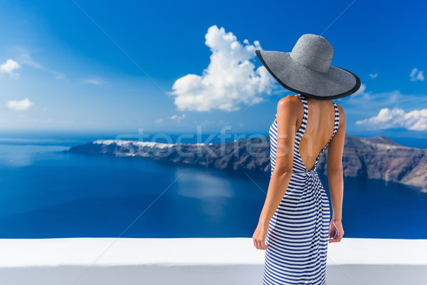 Luxury travel vacation woman looking at Santorini Stock photo © Maridav