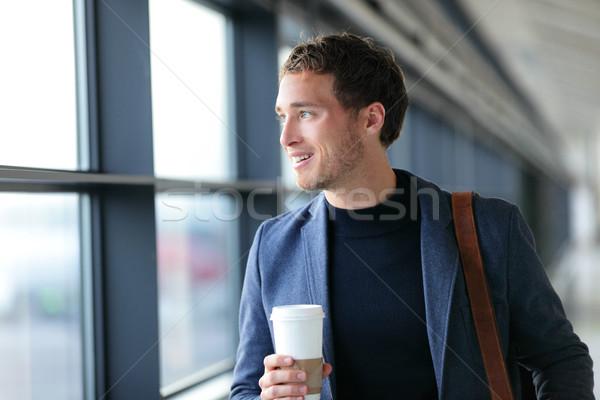 Happy businessman going to work drinking coffee Stock photo © Maridav