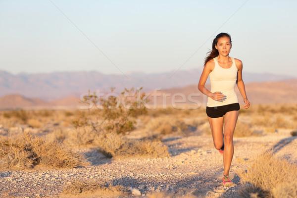 Woman runner running cross country trail run Stock photo © Maridav