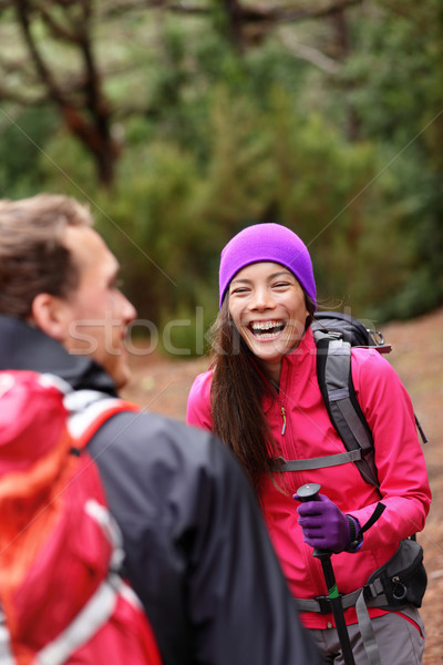 Couple having fun laughing hiking in forest Stock photo © Maridav