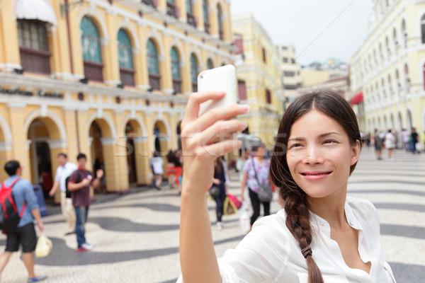 Woman tourist taking selfie pictures in Macau Stock photo © Maridav