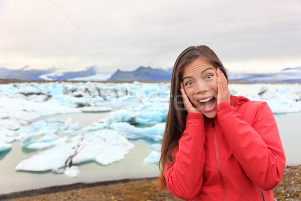 Excited happy woman at glacier lagoon on Iceland Stock photo © Maridav