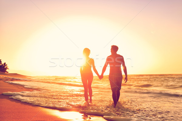 Honeymoon couple on beach in loving relationship Stock photo © Maridav