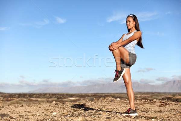 Standing Glutes leg stretch fitness woman workout Stock photo © Maridav