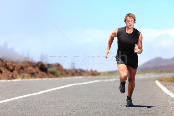 Man running / sprinting on road Stock photo © Maridav
