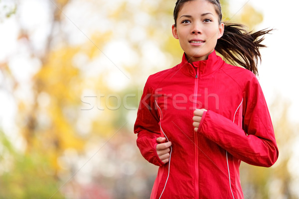 Woman runner running in autumn Stock photo © Maridav