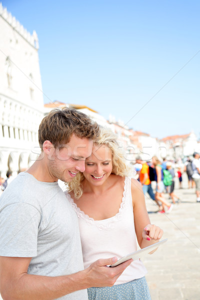 Stock photo: Traveling couple using tablet computer in Venice