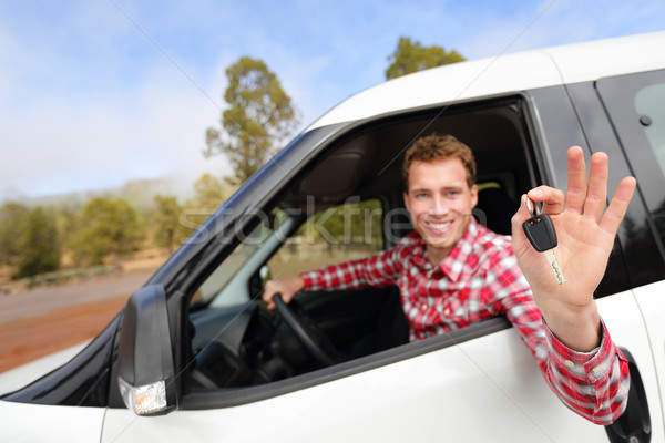 Man driving rental car showing car keys happy Stock photo © Maridav