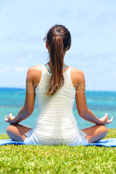 Meditation yoga woman on beach meditating by ocean Stock photo © Maridav