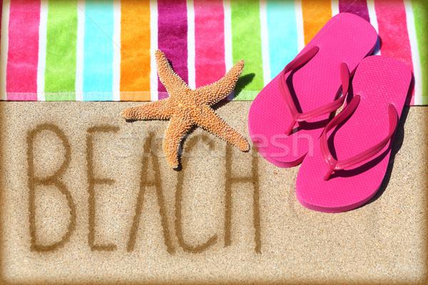 Beach vacation concept - word written in sand Stock photo © Maridav