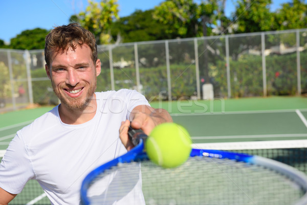 Tennis player portrait man showing ball and racket Stock photo © Maridav