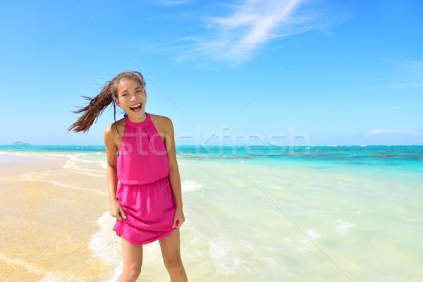Asian Chinese tourist woman having fun on beach Stock photo © Maridav