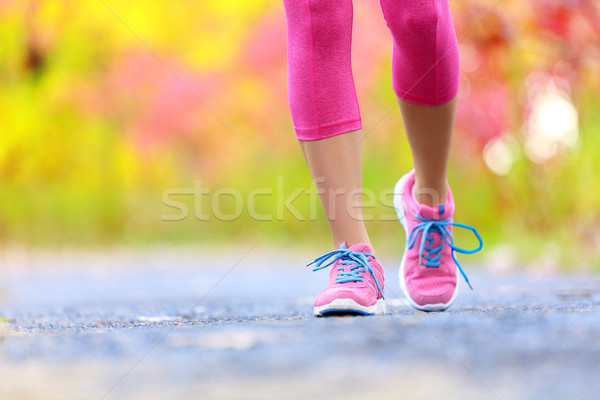 Jogging woman with athletic legs and running shoes Stock photo © Maridav