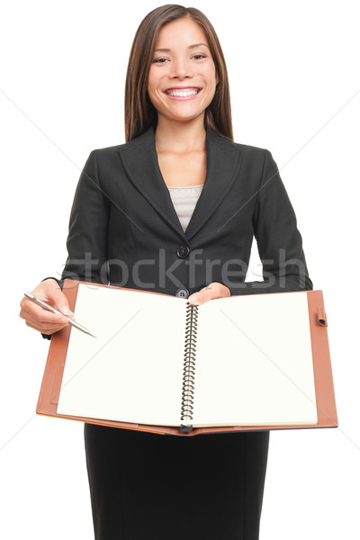 Businesswoman showing blank notebook copyspace Stock photo © Maridav