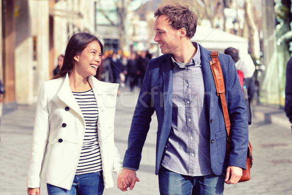 Young dating couple flirting walking in city Stock photo © Maridav