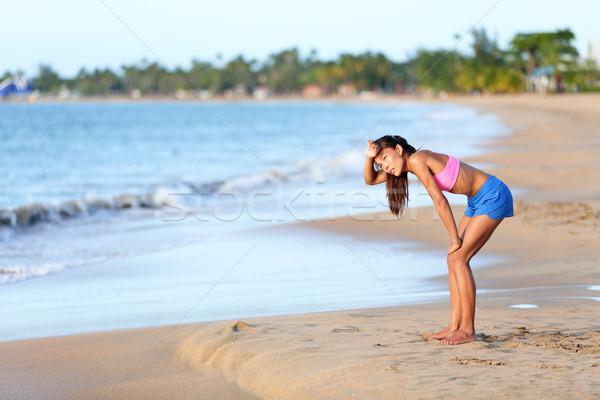Kimerült futó megnyugtató tengerpart fut fáradt Stock fotó © Maridav