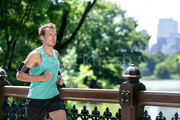 Man jogging in Central park listening to music run Stock photo © Maridav