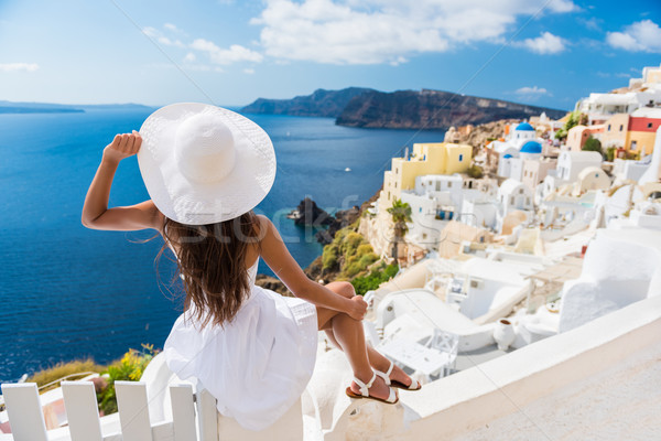 Tourist Enjoying The View Of Oia Village Santorini Stock photo © Maridav