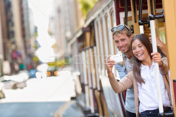 San Francisco cable car couple taking phone selfie Stock photo © Maridav
