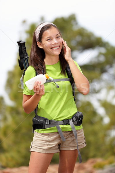 Sunscreen woman hiking applying sun lotion Stock photo © Maridav