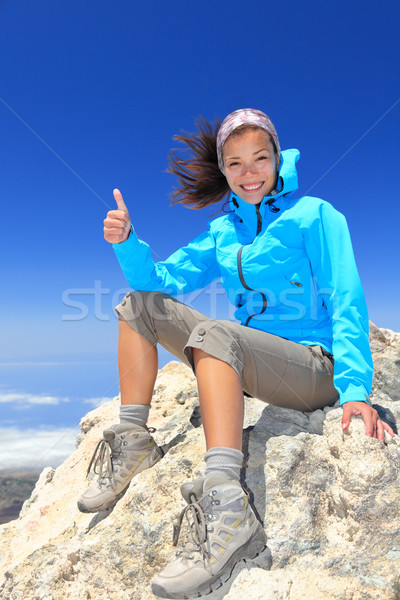 Hiker at mountain top summit Stock photo © Maridav