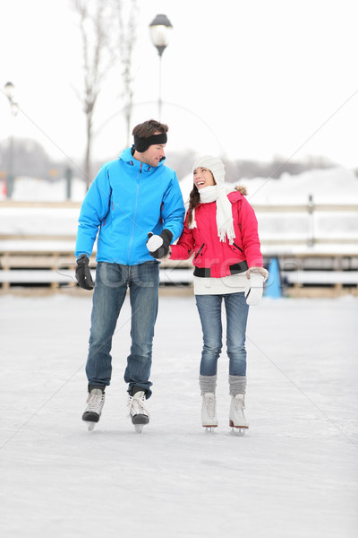 Young couple iceskating outdoors Stock photo © Maridav