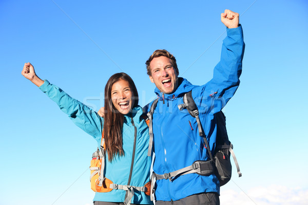 Happy hiking couple cheering Stock photo © Maridav