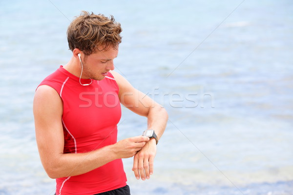 Athlete runner looking at heart rate monitor watch Stock photo © Maridav