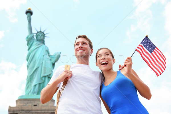 Tourists travel couple at Statue of Liberty, USA Stock photo © Maridav