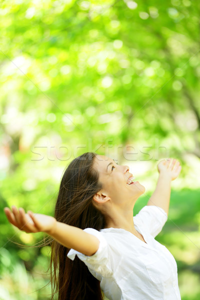 Happy woman rejoice looking up happy Stock photo © Maridav