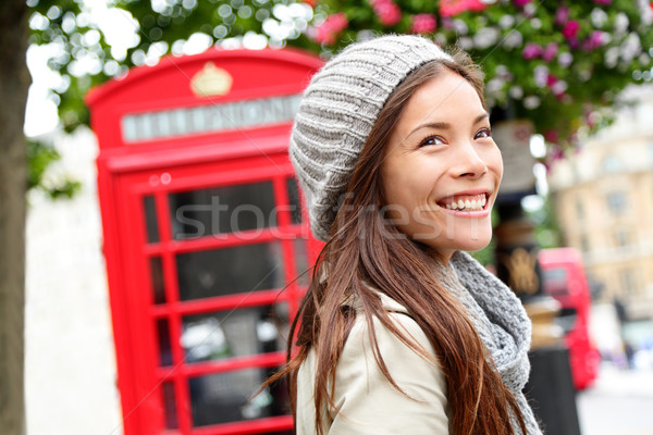 London people - woman by red phone booth Stock photo © Maridav