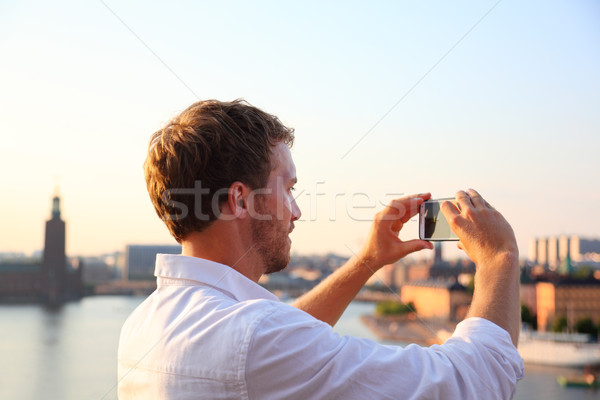 Tourist taking smartphone photograph in Stockholm Stock photo © Maridav