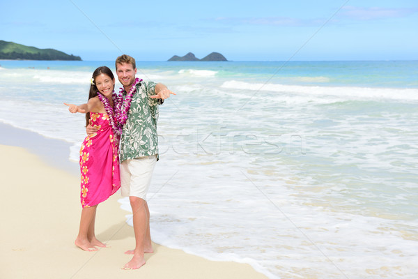 Aloha couple on Hawaiian beach - Hawaii vacations Stock photo © Maridav